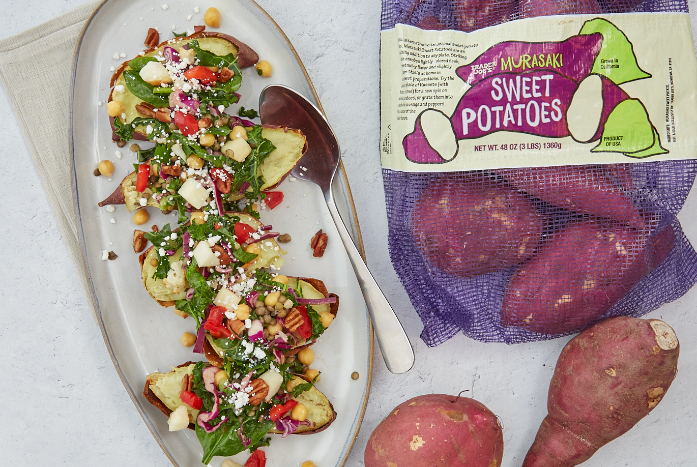 Recipe made with Trader Joe's Murasaki Sweet Potatoes, Lentil Palette Salad Kit and sprinkled with feta cheese